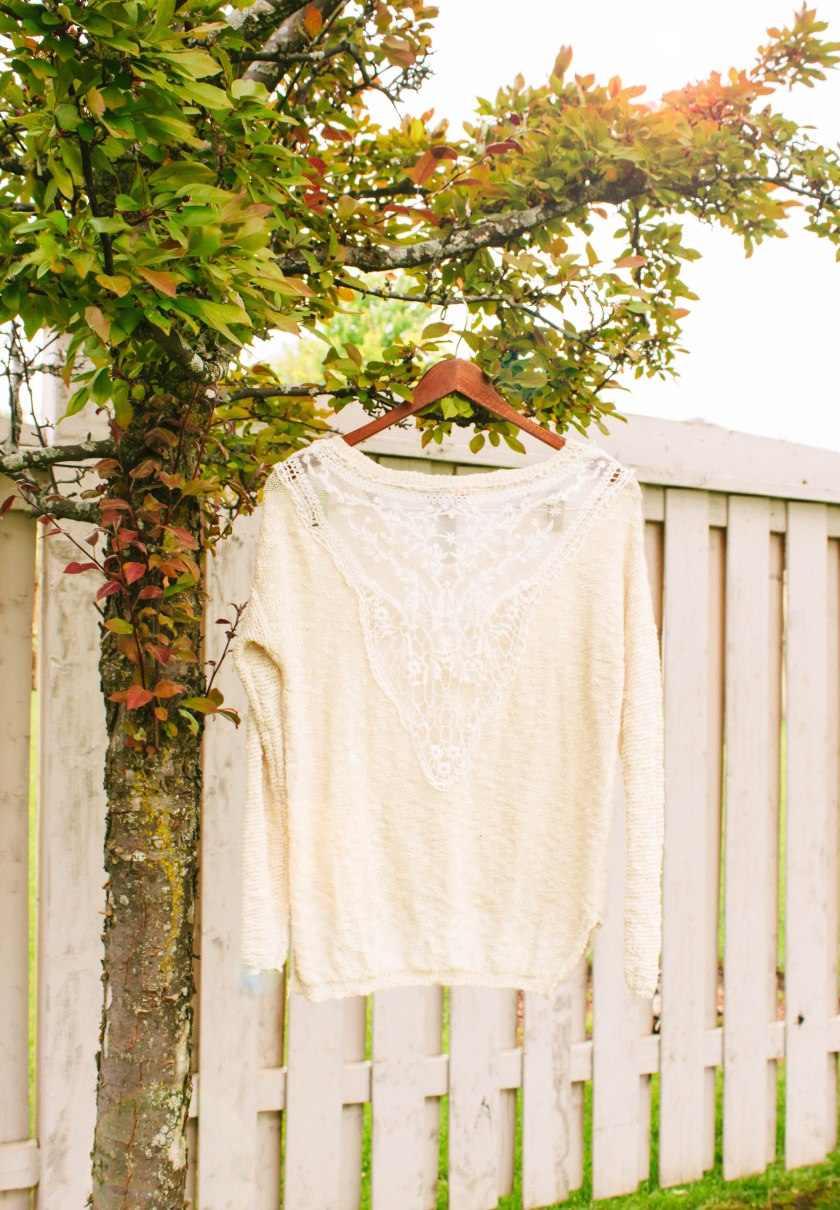 Love the lace details on the back of this sweater