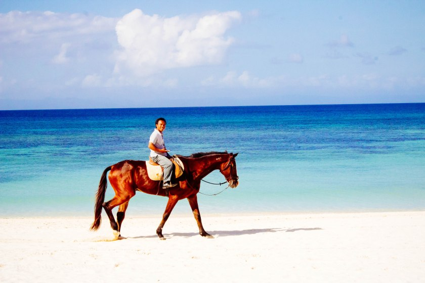 Horseback riding on the beach in Balesin