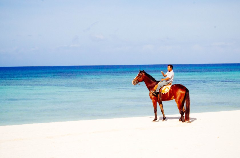 Horseback riding on the beach in Balesin